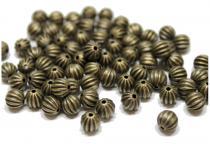 Metallperlen / Spacer gold/bronze